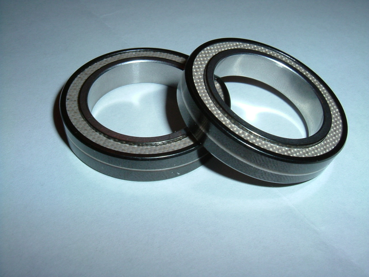 Bearings: This is a picture of the bearings purchased from the Champion Bearing company.  These bearings have an inner diameter of 25mm, and outer diameter of 37mm and a thickness of 7mm.  The bearing specifications are as follows: Stainless Steel races Ceramic Balls Teflon Seals Tungstun disulfide thin film lubricant